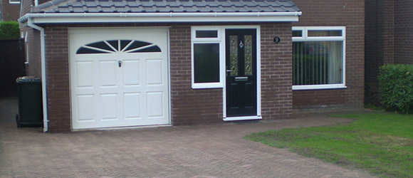 Porch and garage extensions with driveway